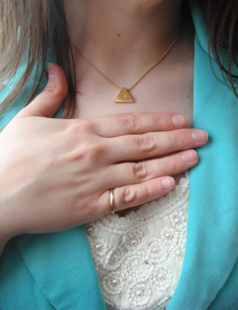 Simple gold jewelry, cream top detail