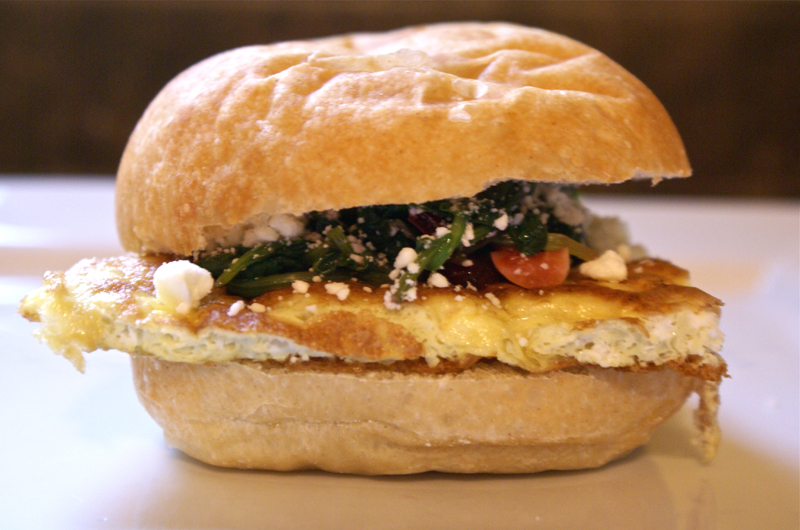 Breakfast egg sandwich - with cooked greens, beets, and feta
