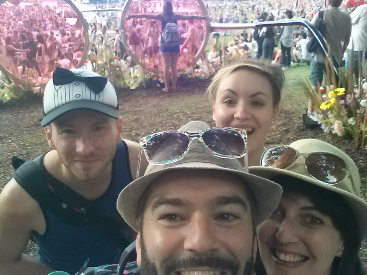 Group selfie in front of Scène de la Vallée and Scène Verte's rose-colored glasses