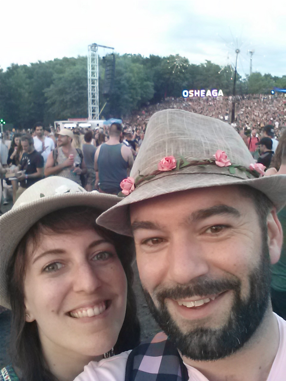 nd one of us in front of the Osheaga sign