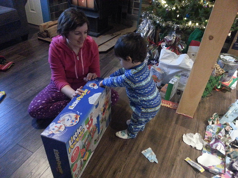Helping the little man open a gift from friends