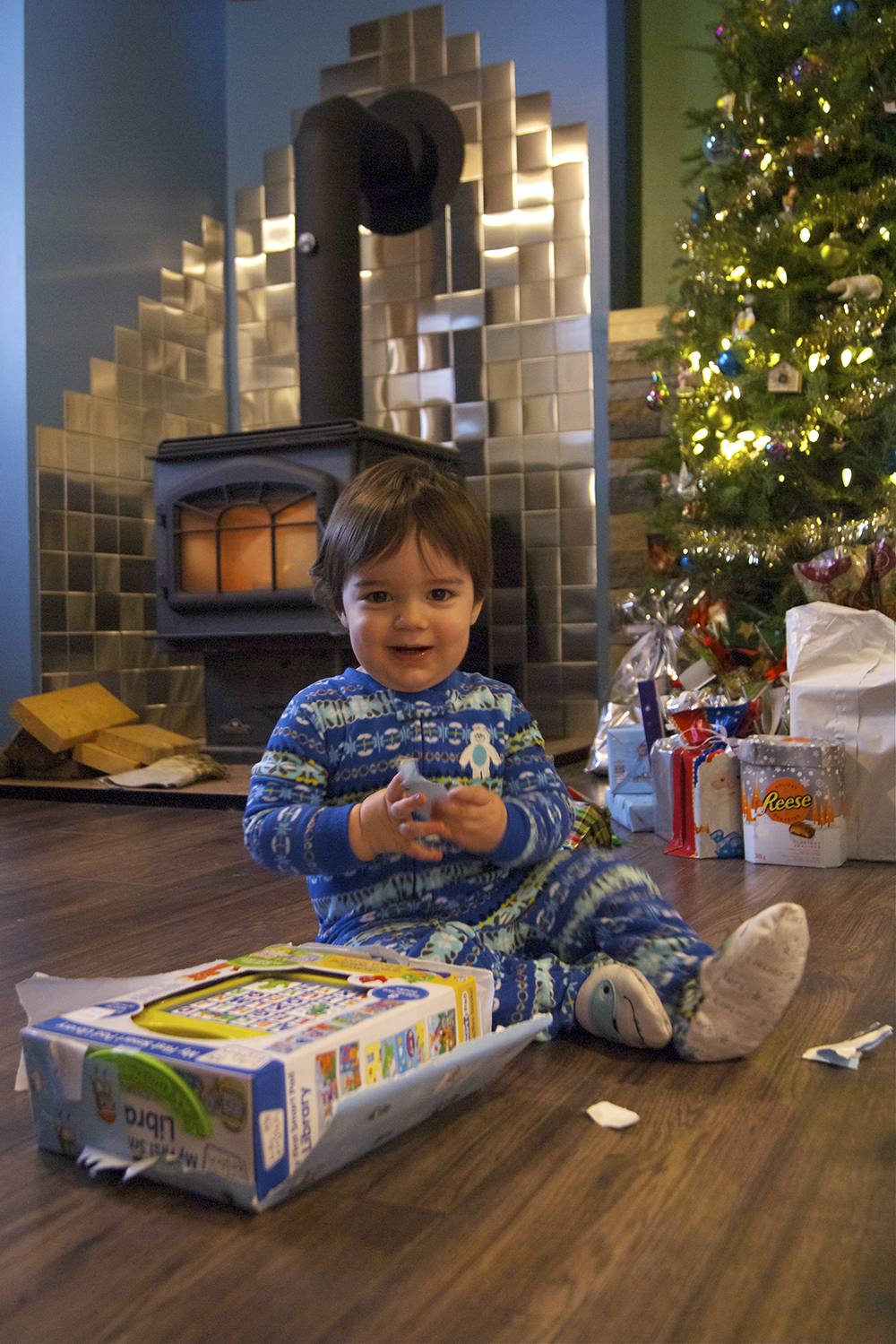 Rowan opening up his gift from mommy and daddy