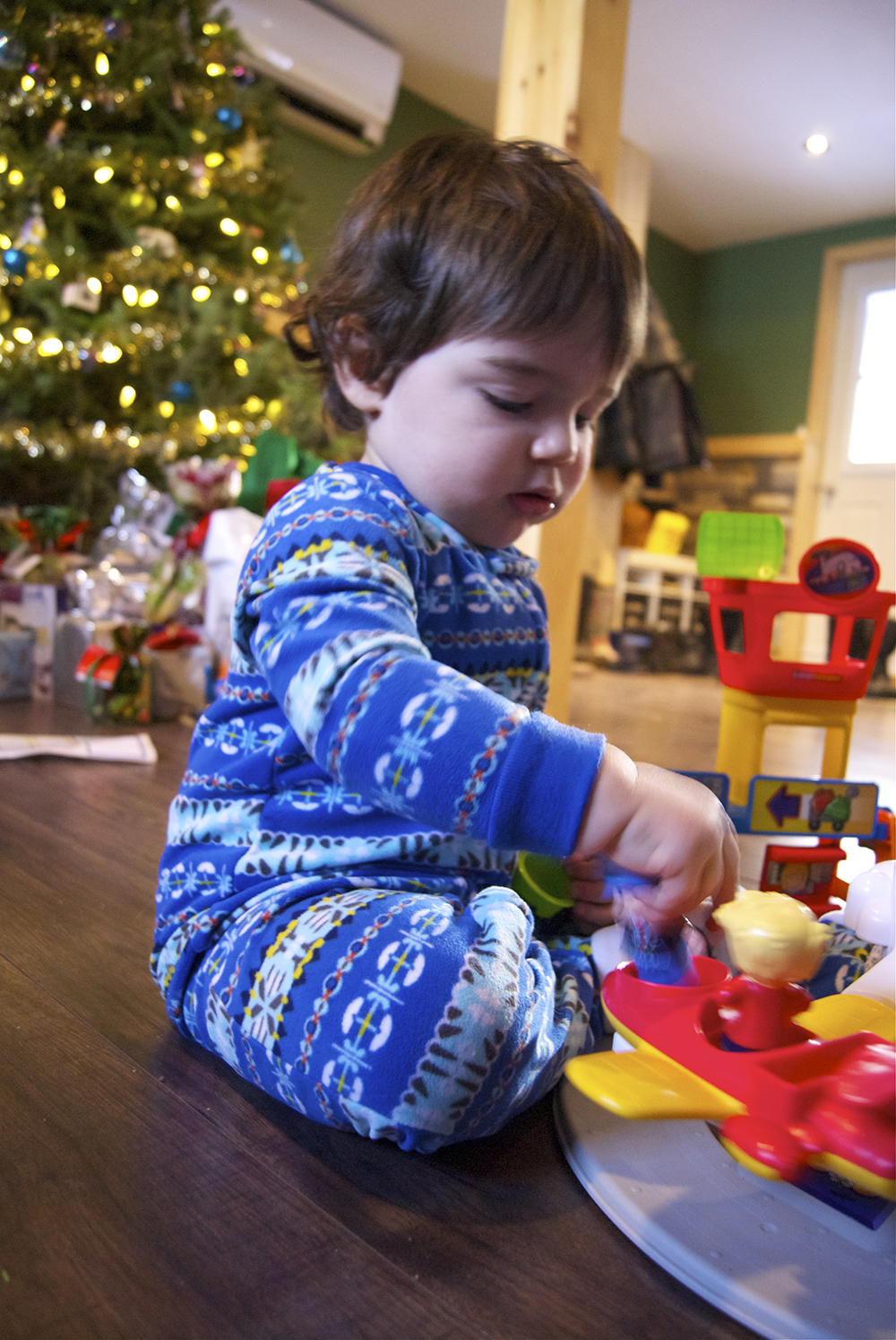 Playing with his new LittlePeople airport from the Carters