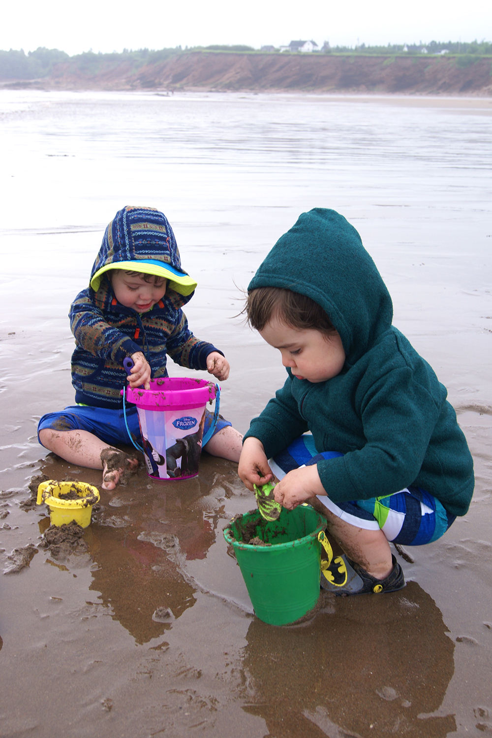 Sam and Rowan playing in the wet sand